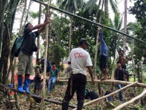Before cultivating the land, Lumad evacuees build camp sites