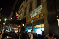 "Light projection on the Philippine Consulate calls on New York to ""Rise Against Extrajudicial Killings"" (PC: Julie Jamora)"